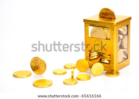 Chocolate money in a gold wrapper - stock photo