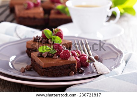 Chocolate  mousse brownies with fresh raspberries and chocolate pieces - stock photo
