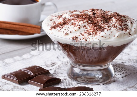 chocolate mousse with whipped cream in a glass and coffee on the table close-up.  - stock photo