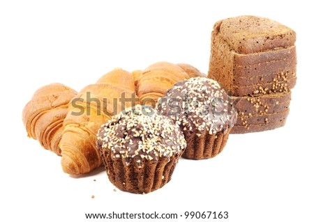 Chocolate muffin with nuts, croissants and brown bread  on white background - stock photo