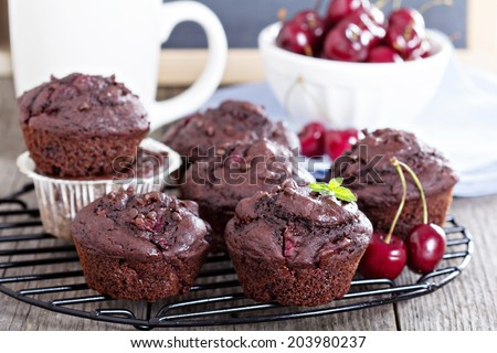 Chocolate muffins with cherry and chocolate drops - stock photo