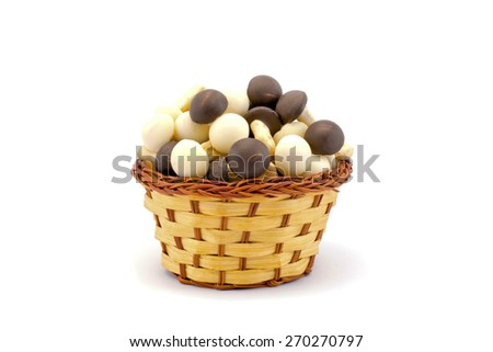 chocolate mushrooms in a basket on a white background - stock photo