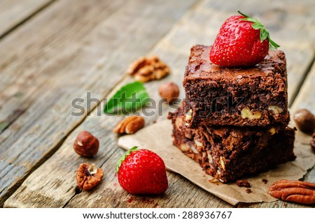 chocolate nut brownie cake decorated with strawberries. the toning. selective focus - stock photo