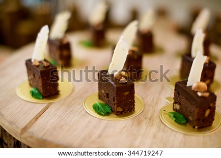 Chocolate Nut Brownies desserts with strawberries at buffet in a restaurant - stock photo