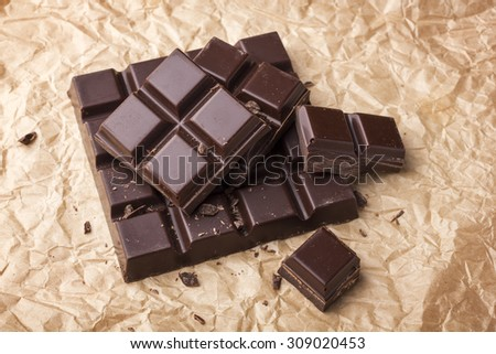 Chocolate on paper background - stock photo