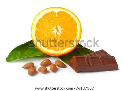 Chocolate, orange, hazelnuts on the white background. Isolated path included. - stock photo