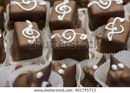chocolate pastries decorated with white sugar - stock photo