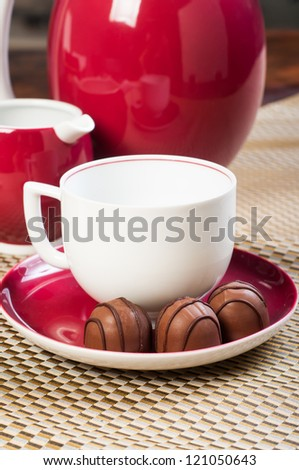 chocolate praline with a cup of coffee ready to serve - stock photo