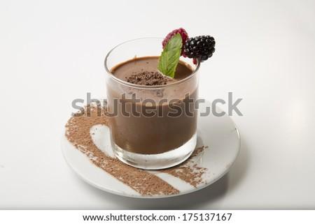 Chocolate pudding mousse dessert with cinamon isolated on white horizontal - stock photo
