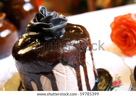 Chocolate rose on a top of a Easter cake - stock photo