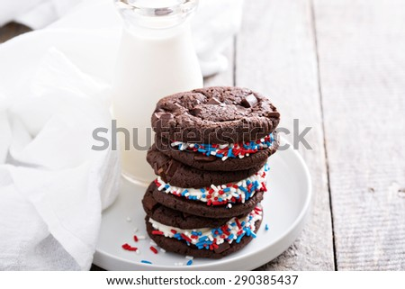 Chocolate sandwich cookies with creamy filling and milk - stock photo