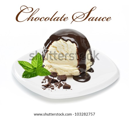 Chocolate sauce on vanilla ice cream with chocolate pieces and mint - stock photo