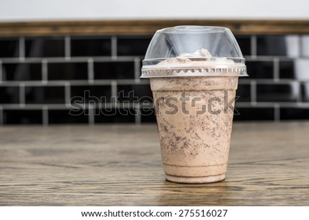 Chocolate smoothie on rustic wooden table - stock photo