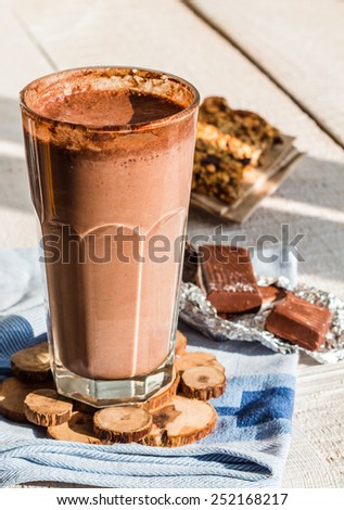 chocolate smoothie with a banana with milk in a glass, healthy food - stock photo