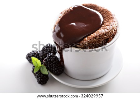 Chocolate souffle with thick chocolate ganache glaze - stock photo
