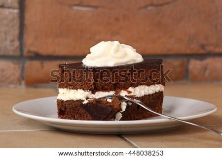 Chocolate Sponge Cake filled with whipped cream. Cream Pie. - stock photo