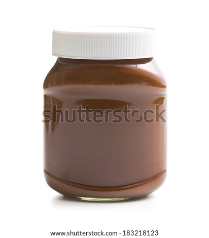 chocolate spread in jar on white background - stock photo