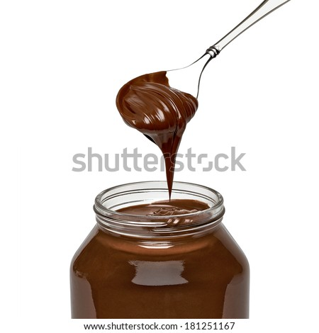 Chocolate spread in spoon with jar on white background - stock photo