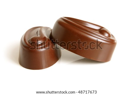 Chocolate sweets on a white background - stock photo