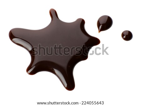 Chocolate syrup drips isolated on white - stock photo