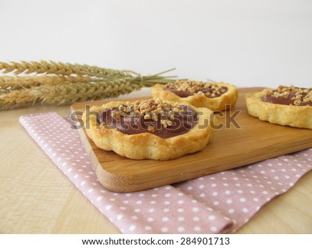 Chocolate tartlets with almonds - stock photo