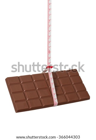 Chocolate, tied with a measuring tape - stock photo