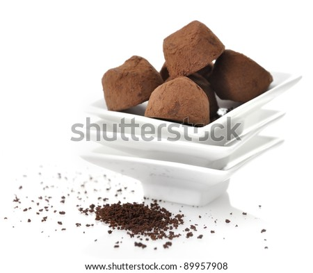 Chocolate Truffles In White Dish , Close Up - stock photo