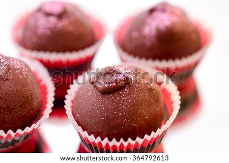 Chocolate Truffles with focus on foreground - stock photo