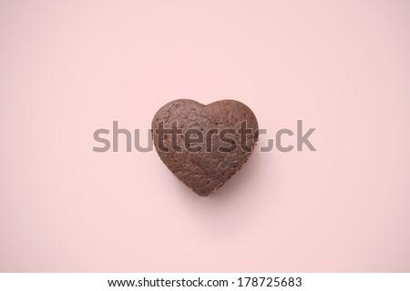 Chocolate Valentine Cake on pink background (heart shape) - stock photo