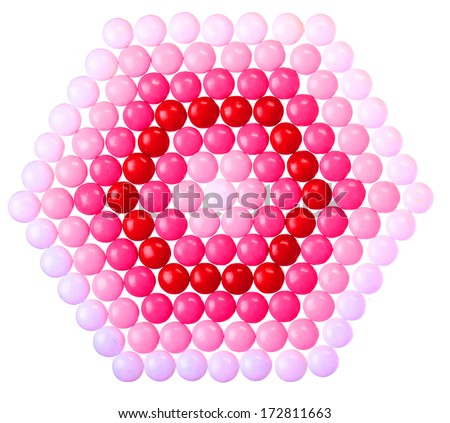 Chocolate Valentine's candy coated in pink, red and white isolated - stock photo