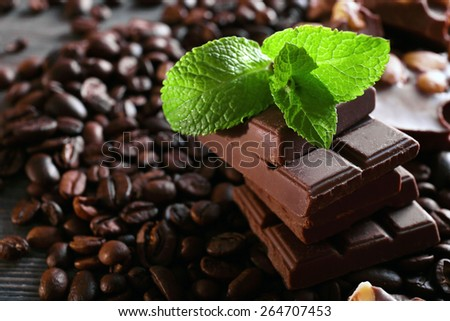 Chocolate with mint and coffee beans, closeup - stock photo