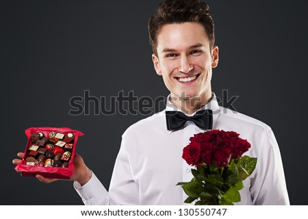 Chocolates and flowers for you! - stock photo