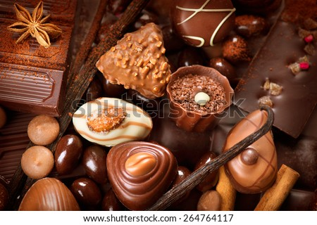 Chocolates background. Chocolate. Assortment of fine chocolates in white, dark, and milk chocolate. Praline Chocolate sweets - stock photo