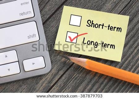 choice of long term decision versus short term - stock photo
