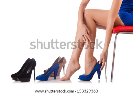 Choice of woman shoes on white - stock photo