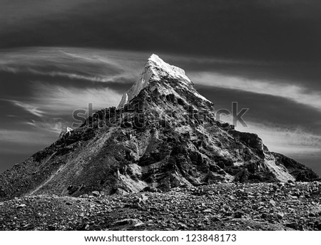 Chola Peak (6069 m) in the area of Cho Oyu - Gokyo region, Nepal (black and white) - stock photo