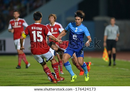 CHONBURI-FEB 9,2014: Nattapong (blue) player of Chonburi FC in action during football AFC Champions League 2014 between Chonburi FC and South China at Chonburi Stadium on February 9,2014 in Thailand - stock photo