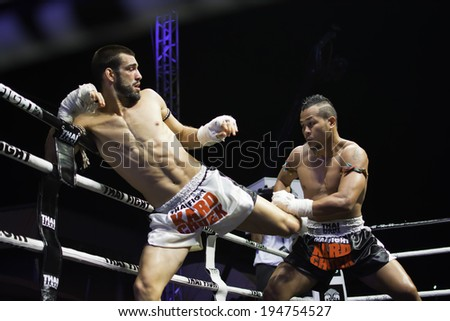 CHONBURI, THAILAND- APRIL 6 : Unidentified boxers compete in Thai Fight:Muay Thai World's Unrivaled Fight on  April 6, 2013 , at Chonburi ,  Thailand - stock photo