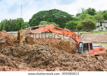 CHONBURI,THAILAND - AUGUST,23 : Backhoe on the construction at digging the pit. Preparatory work for the construction of grain silos in Cjpmbiro,Thailand on August 23,2015 - stock photo