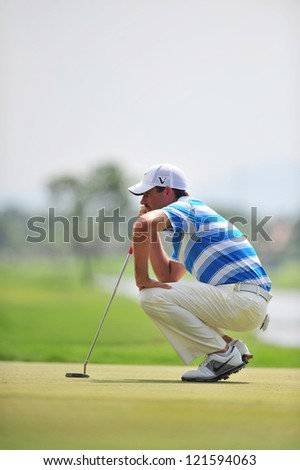 CHONBURI, THAILAND - DECEMBER 8 : Charl Schawartzel in action during The Golf Championship Thailand Round 3 at Ammata Spring Country Club on December 8, 2012 in Chonburi, Thailand. - stock photo