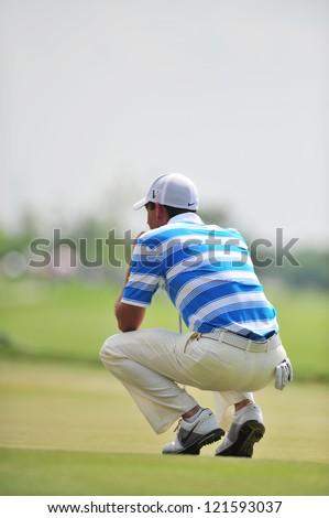 CHONBURI, THAILAND - DECEMBER 8 : Charl Schwartzel in action during The Golf Championship Thailand Round 3 at Ammata Spring Country Club on December 8, 2012 in Chonburi, Thailand. - stock photo