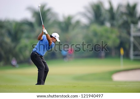 CHONBURI,THAILAND-DECEMBER 6:Chinnarat Phadungsil of Thailand plays a shot during hole 3 day one of the Thailand Golf Championship at Amata Spring Country Club on December 6,2012 in Chonburi,Thailand. - stock photo