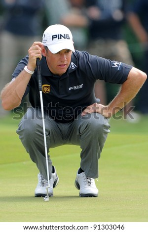 CHONBURI, THAILAND - DECEMBER 15: Lee Westwood of England plays a shot during day one of the Thailand Golf Championship at Amata Spring Country Club on December 15, 2011 in Chonburi, Thailand. - stock photo