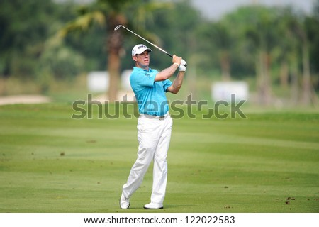 CHONBURI,THAILAND-DECEMBER 6: Lee Westwood of England watches the ball after hits a shot during hole 2 day one of the Thailand Golf Championship at Amata Spring Country Club on Dec 6,2012 in,Thailand. - stock photo