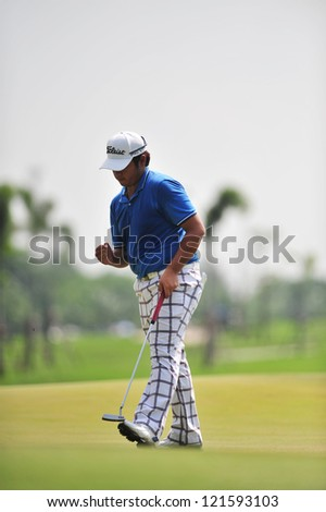 CHONBURI, THAILAND - DECEMBER 8 : Thitiphun Chuaprakong in action during The Golf Championship Thailand Round 3 at Ammata Spring Country Club on December 8, 2012 in Chonburi, Thailand. - stock photo