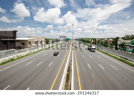CHONBURI-THAILAND - JUNE 28 : The lanes with high speed cars on the motorway from Bangkok to Pattaya on June 28,2015 - stock photo