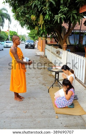 CHONBURI - THAILAND , MAR 13 - 2016 : Thailand's popular morning alms give food to monk. The Buddhist clergy as religious beliefs. - stock photo