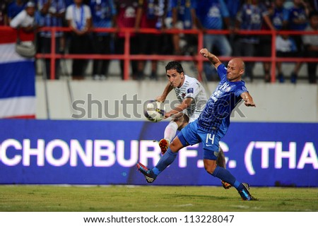 CHONBURI,THAILAND-SEPTEMBER 18:Ali Ghalioum (white)of Al Shorta (SYR) in action during the AFC CUP quarter finals between Chonburi fc.and Al Shorta (SYR) at Chonburi Stadium on Sep18,2012 in Thailand - stock photo