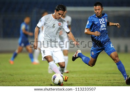 CHONBURI,THAILAND-SEPTEMBER18:Ali Ghalioumof (white)Al Shorta (SYR)for the ball during the AFC CUP quarter finals between Chonburi fc.and Al Shorta (SYR) at Chonburi Stadium on Sep18,2012 in Thailand - stock photo