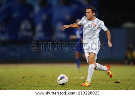 CHONBURI,THAILAND-SEPTEMBER18:Ammar Zakour of Al Shorta (SYR) contols the ball during the AFC CUP quarter finals between Chonburi fc.and Al Shorta (SYR) at Chonburi Stadium on Sep18,2012 in Thailand - stock photo